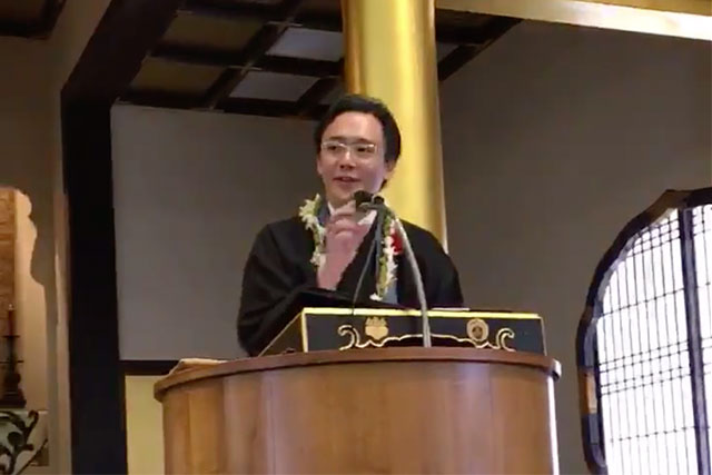 Rev. Satoshi Tomioka giving a dharma message at Moiliili Hongwanji